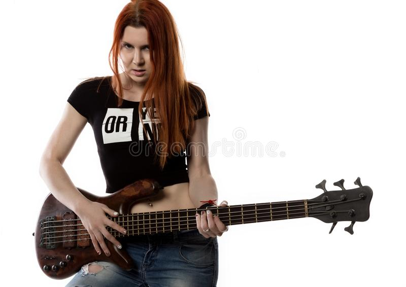 Redhead woman holding electric guitar on a white background. rock girl playing on a guitar. free space for text stock photography