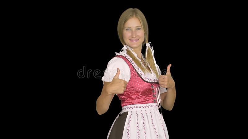 Sexy Oktoberfest waitress, wearing a traditional Bavarian dress.  stock image