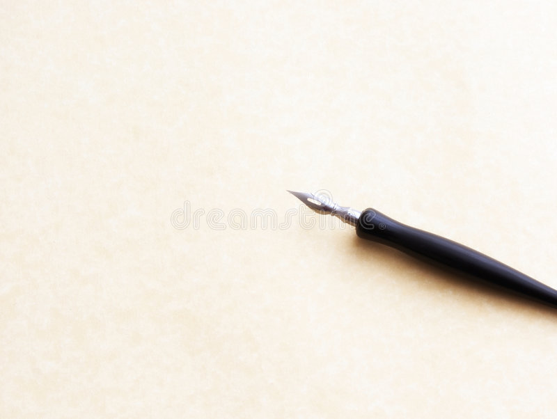 Pen. Old fashioned ink dip pen for writing or drawing on parchment paper background stock images