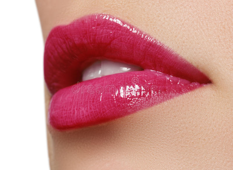 Pink wet lip makeup. Close-up of beautiful full lips. Glossy Lips. Lip Makeup.Beautiful Make-up.Sensual mouth. lipstick or Lipgloss.Professional Facial Makeup stock images