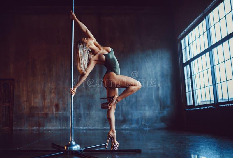 pole dancing woman stock photography