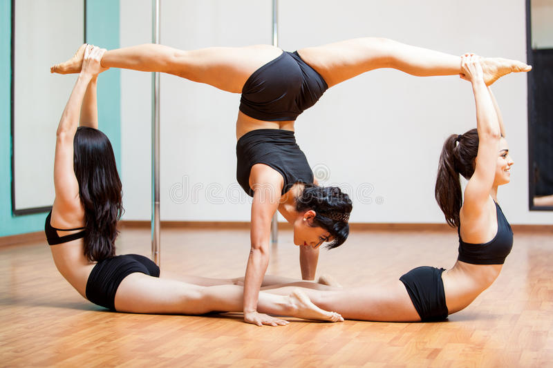 Pole fitness group pose stock photo. Image of young ...