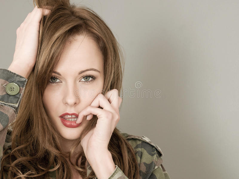 Portrait Of A Woman Wearing an Army or Military Camouflage. Portrait Of A Nervous Anxious Woman Wearing an Army or Military Camouflage Casual Jacket royalty free stock image
