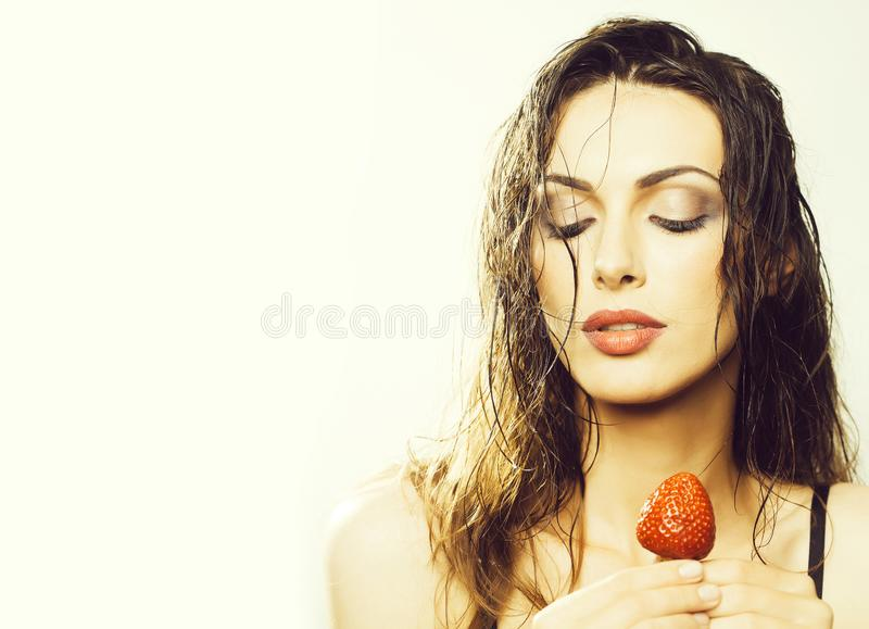 Sexy pretty woman with red strawberry stock photo