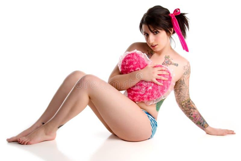 punk pin-up girl with heart stock photos