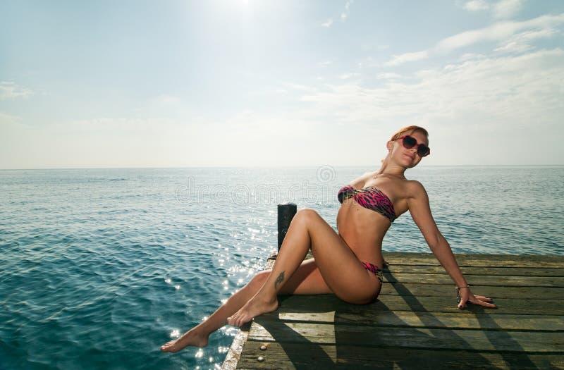 red girl wearing bikini at stock image