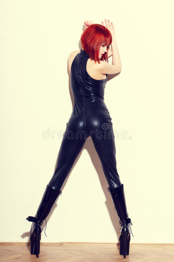 Download Redhead Dominatrix Woman In Latex Catsuit Posing At Wall Stock Image - Image of high, secret: 81087807