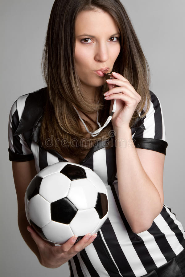 Referee. Soccer referee blowing whistle royalty free stock photos