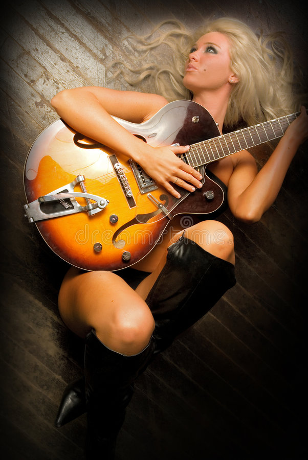 Rocker Chick. Image of a model with an electric guitar. Jessica Crider is a model and TV personality and celebrity stock photo
