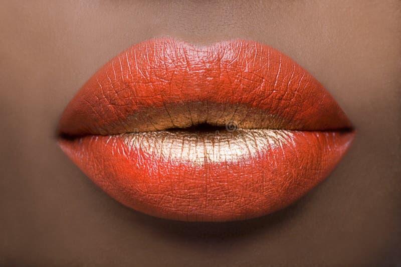 Sexy Rode en Gouden Lippen stock afbeelding