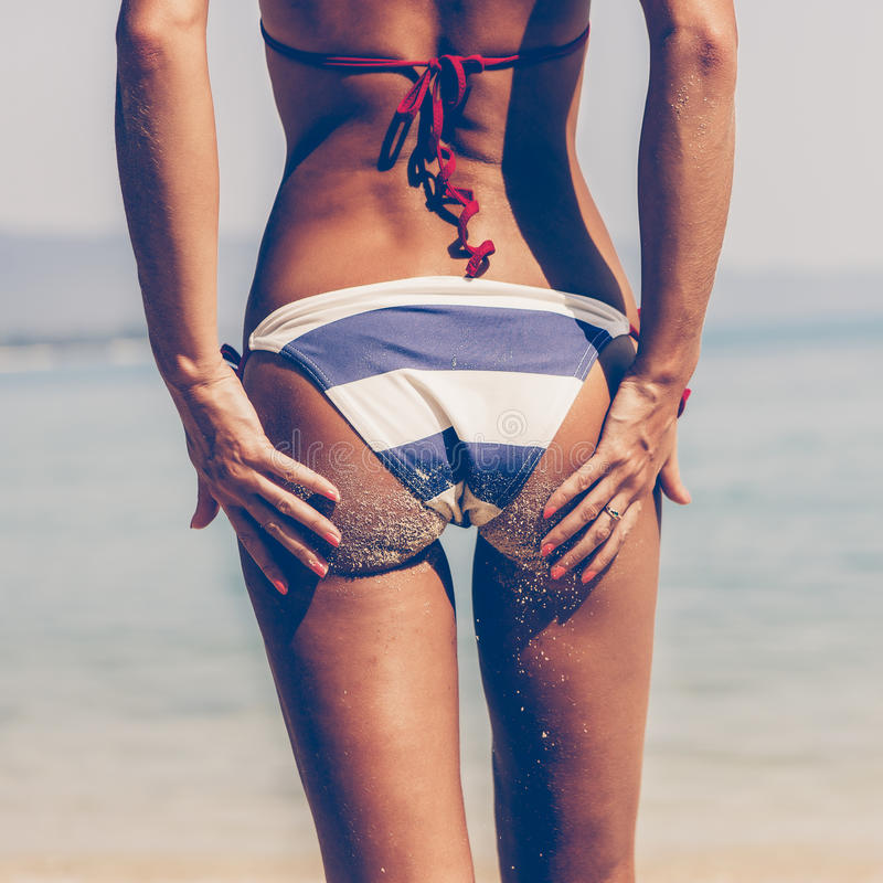 sandy woman buttocks in blue and white striped bikini on th royalty free stock photo