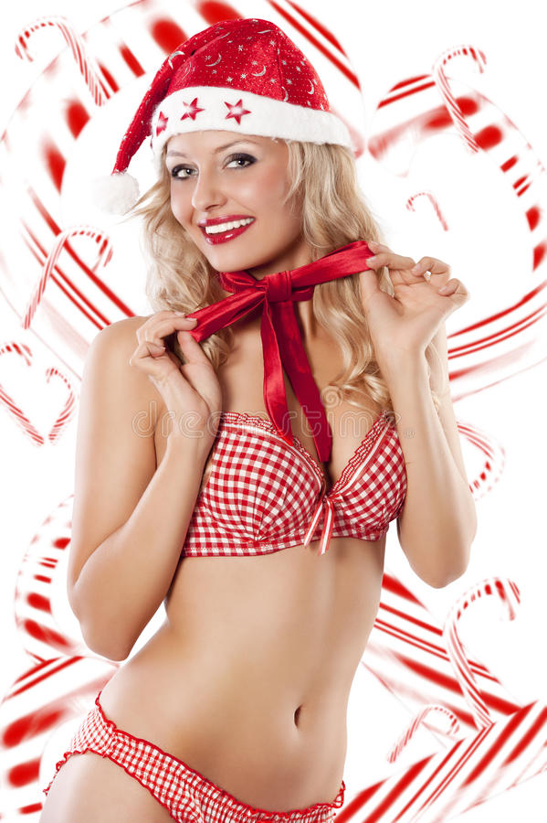 Santa Claus And Candy Canes Royalty Free Stock Image