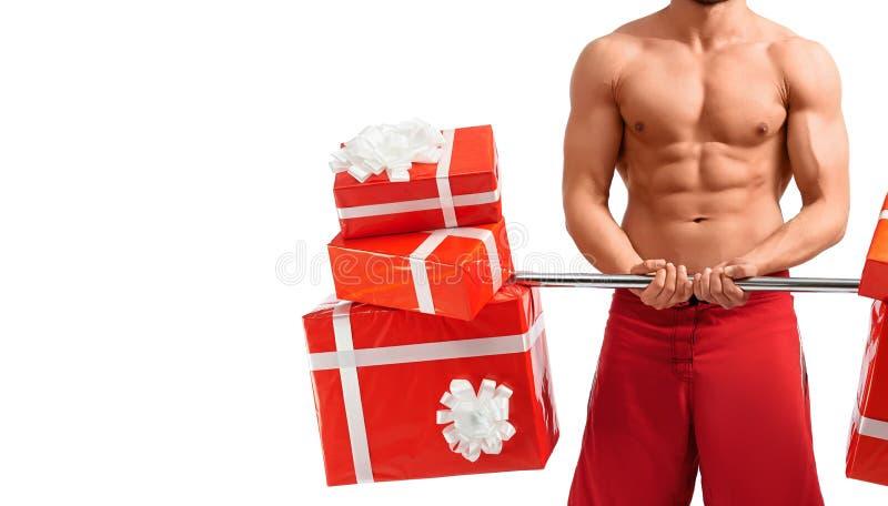 Sexy Santa Claus-Mann mit einem Barbell stockbild