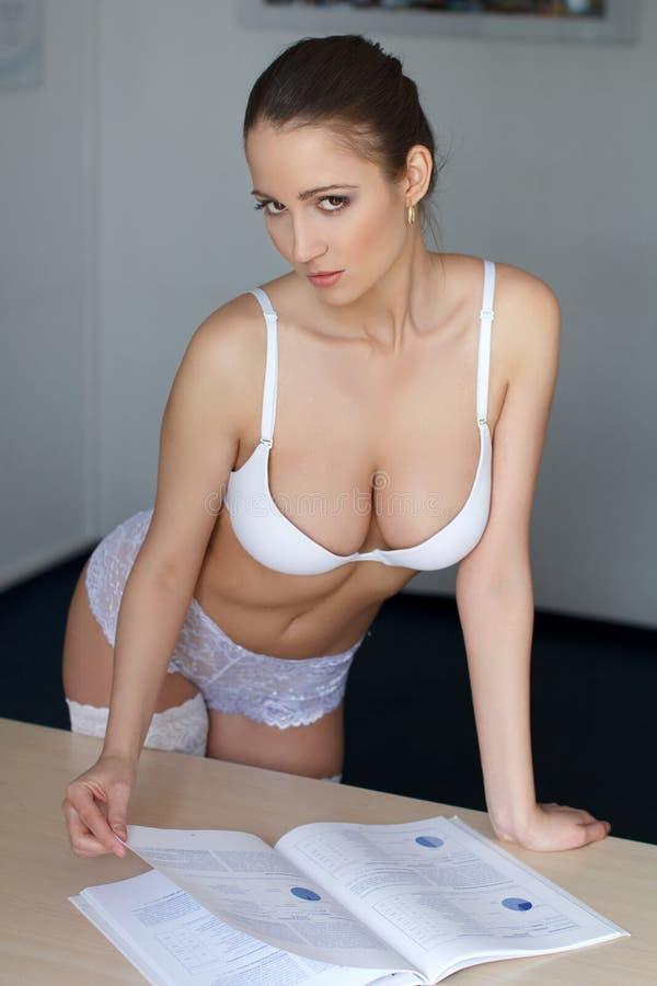 Sexy secretaresse met catalogus royalty-vrije stock foto