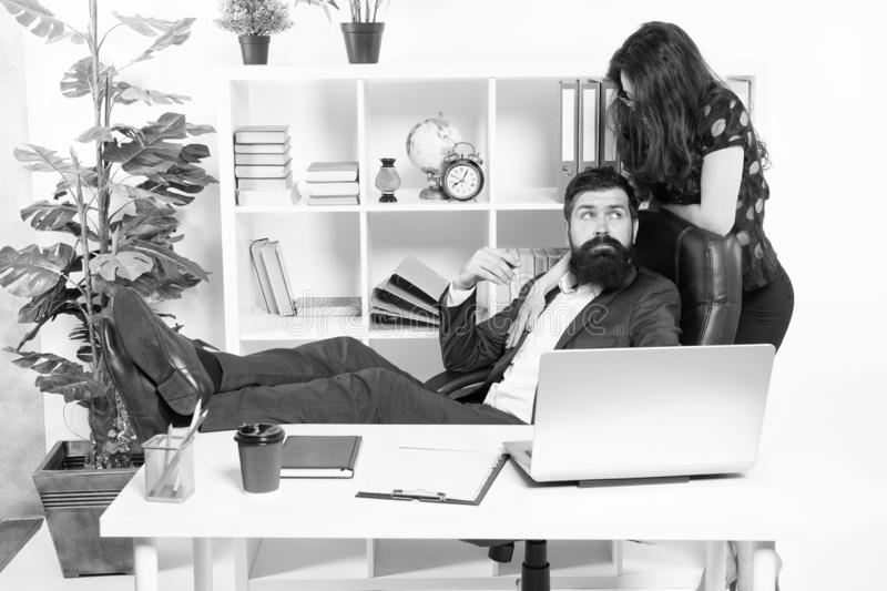Sexy secretary personal assistant. Typical office life. Man bearded hipster boss sit in leather armchair office interior stock photo