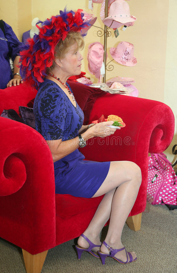 Senior legs. Senior society woman with extremely legs in purple heels royalty free stock image