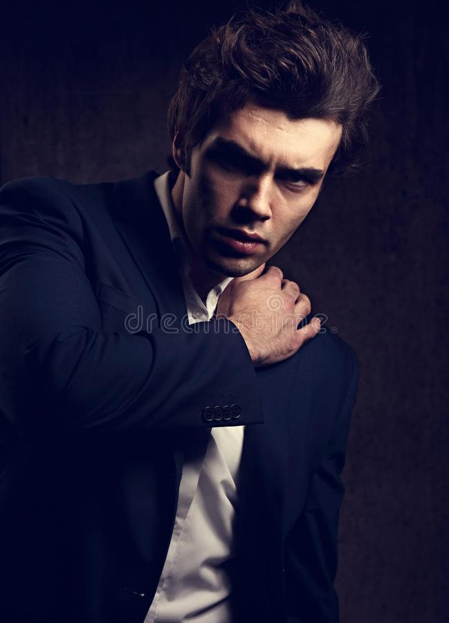 serious business man posing in blue suit and white style sh royalty free stock images