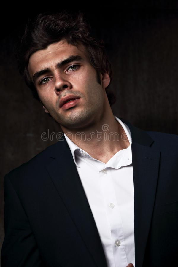 serious male business model posing in blue suit and white s stock photos
