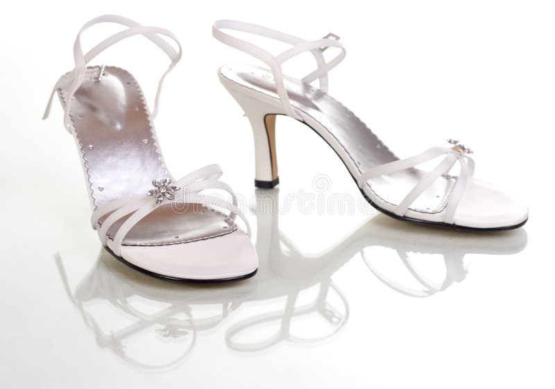 Shoes. White heels on glass