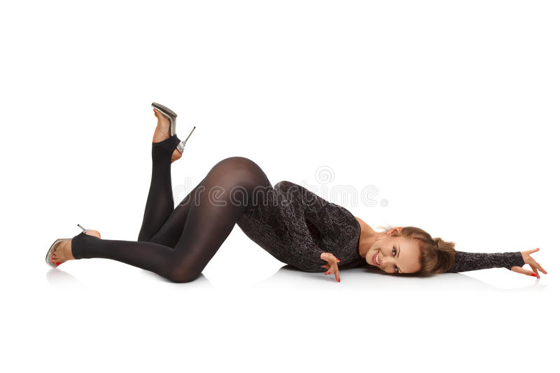 Showgirl. Young blonde woman dancing in night club on white background stock image