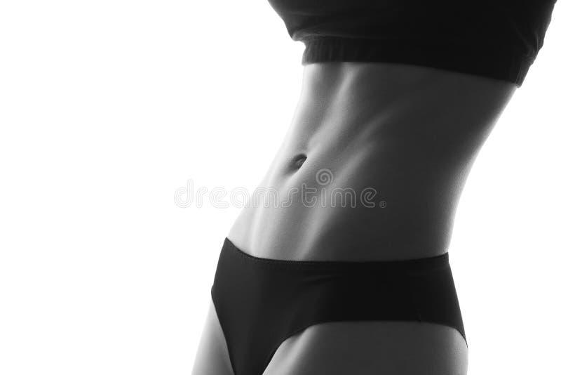 Sexy slanke geschikte abs van het vrouwenlichaam Gespierde buik sportkleding isola royalty-vrije stock afbeeldingen