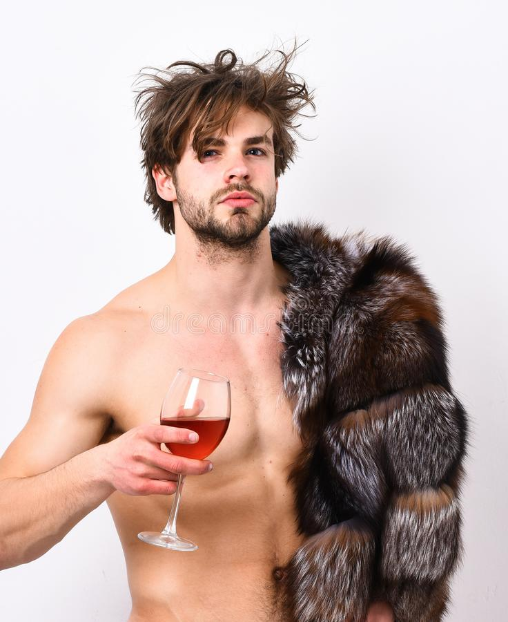 Sleepy macho tousled hair drink wine or alcohol isolated on white. Luxury status symbol. Luxury lifestyle and. Wellbeing. Richness and luxury concept. Guy royalty free stock images