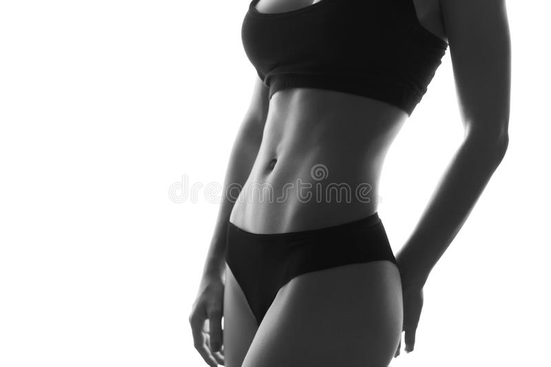 slim fit woman body abs. Muscled abdomen. Sportswear. Isola royalty free stock photos