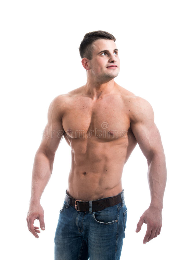 Smiling shirtless male model with muscular body and abs against isolated white background looking to the camera. Torso of strong guy in jeans against white stock photos