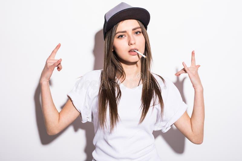 Smoking beautiful woman in cap with cigar closeup studio shot. Smoking beautiful woman cigar closeup studio shot royalty free stock photo