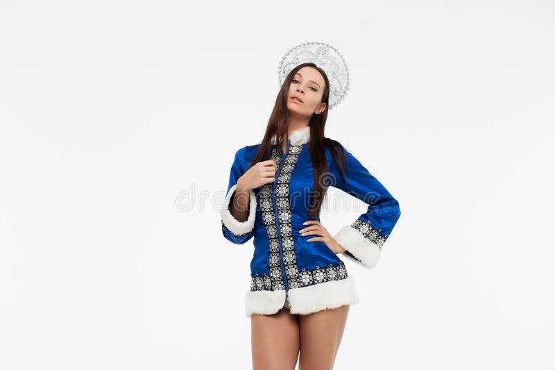 Sexy Snow Maiden looking at camera royalty free stock images