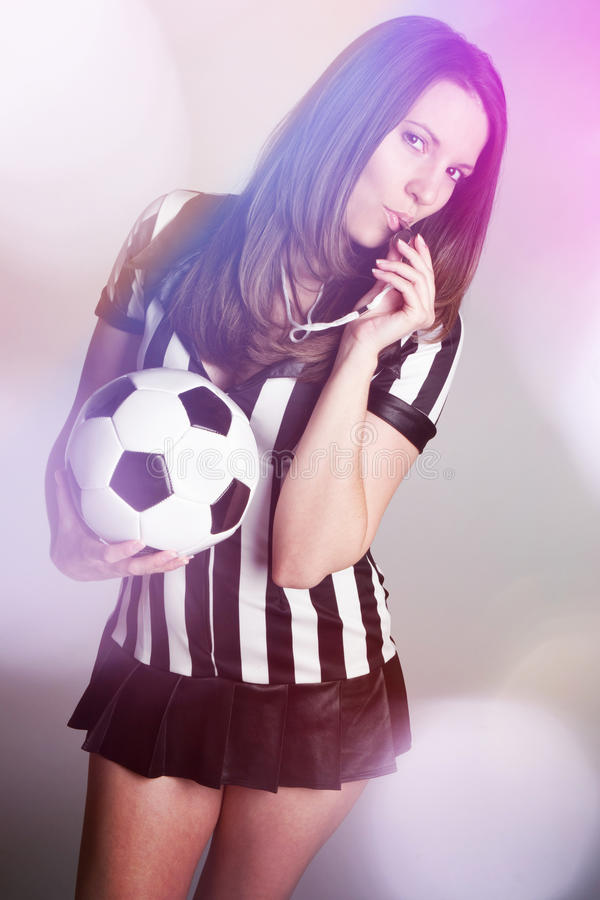 Soccer Referee. Girl holding ball stock photography