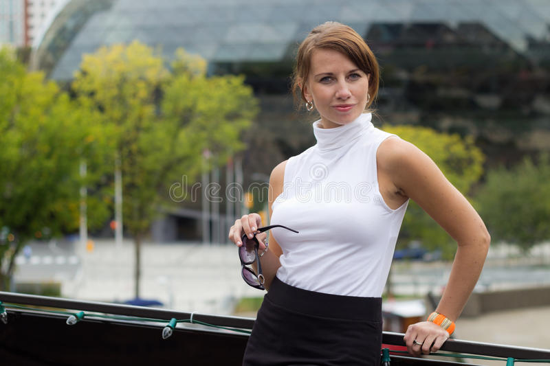 Sexy, sophisticated woman poses in urban city area. A sexy, sophisticated woman poses in urban city area stock photo