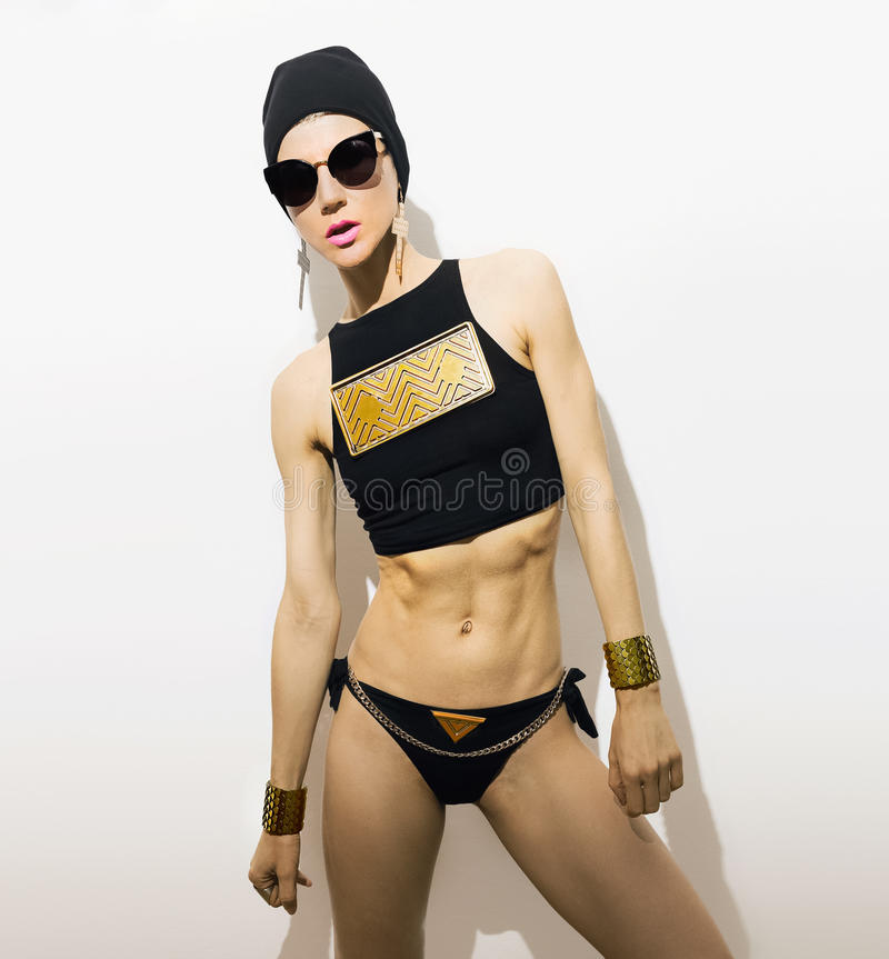 Sports girl in fashionable clothes. Metal, Swаg, Glamour royalty free stock photography