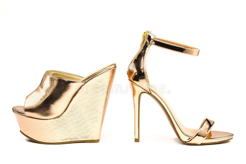 Stiletto high heels and platform mules shoes in metallic colors. Stiletto high heels with ankle strap and heavy platform mules in shiny metallic color, isolated stock photos