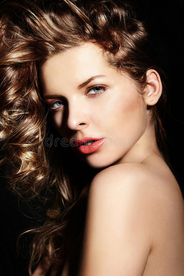 Stylish brunette Caucasian young woman model with bright makeup, with curly healty hair with blue eyes big lips in studio. High fashion look.glamor closeup stock photo