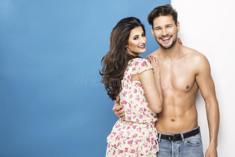 Summer couple. Over blue background royalty free stock photos