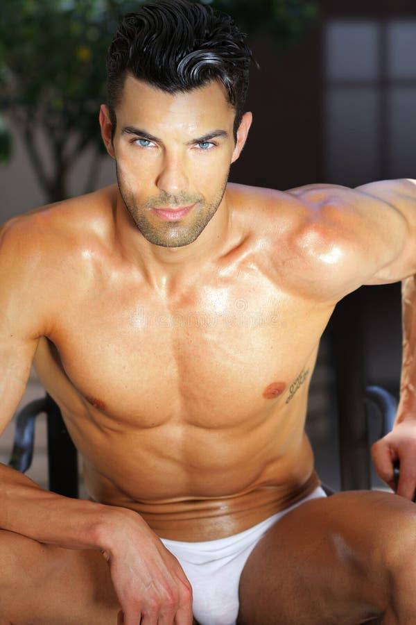 Summer guy. Outdoor summer portrait of male model relaxing in underwear stock image