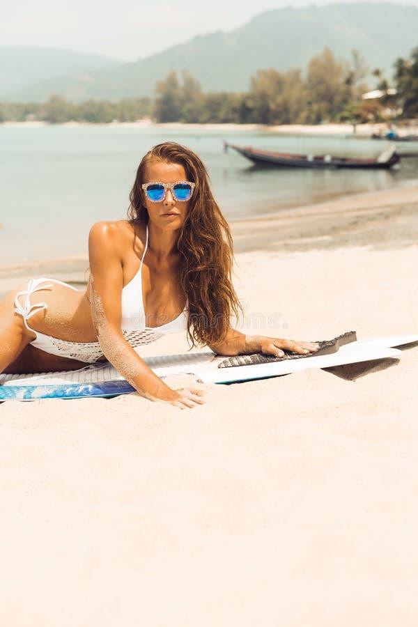 surfer girl on the sea ocean beach. stock image
