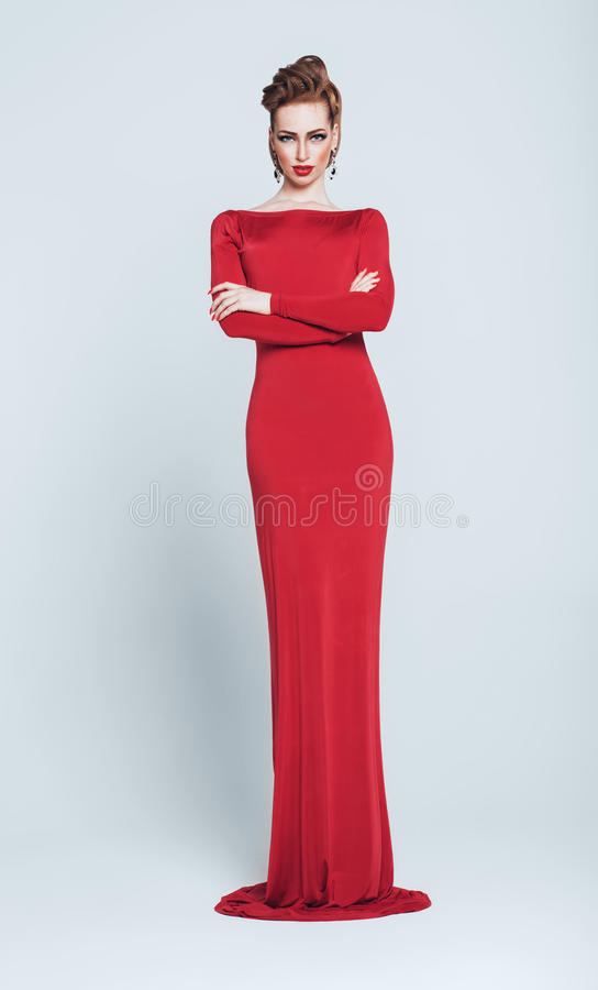 tall woman in long red dress stock photo