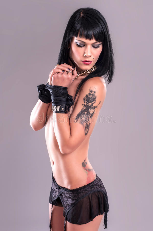 Tattoo Girl with Tied Hands royalty free stock images