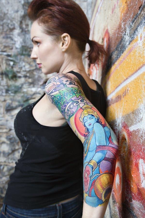 tattooed woman. royalty free stock image