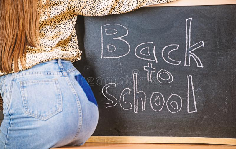 Sexy teacher seduces you to continue studying or enter private school. Buttocks seductive teacher near chalkboard stock images