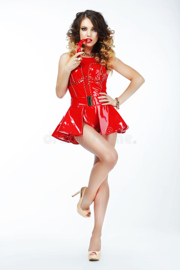 Tempting Dominatrix in Vivid Art Costume with Chili Pepper stock image