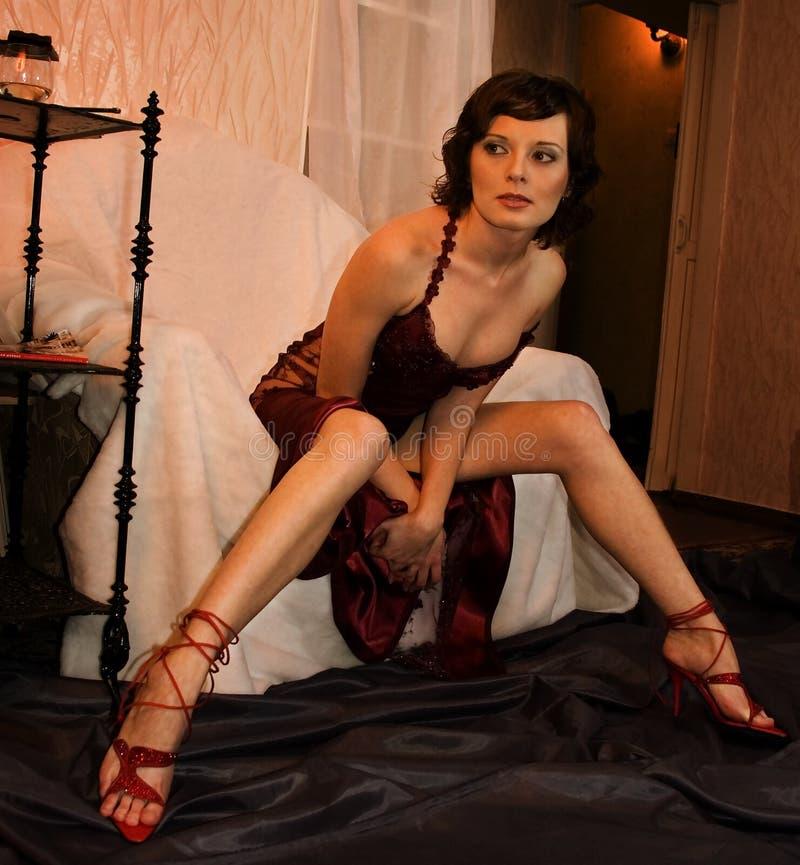 Sexy vrouw als voorzitter stock fotografie