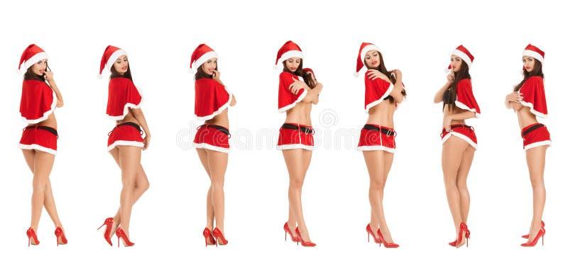 Sexy vrouw die de kleren van de Kerstman draagt royalty-vrije stock foto
