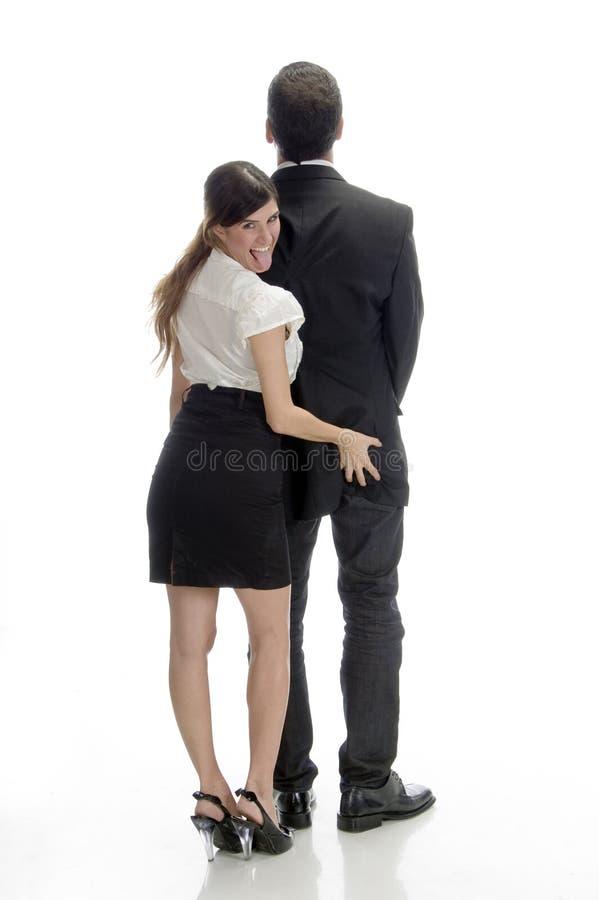 Sexy vrouw die man rug duwt stock afbeeldingen