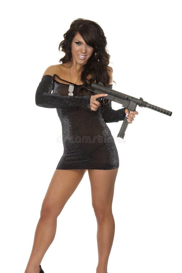 Sexy vrouw die submachine houdt stock foto