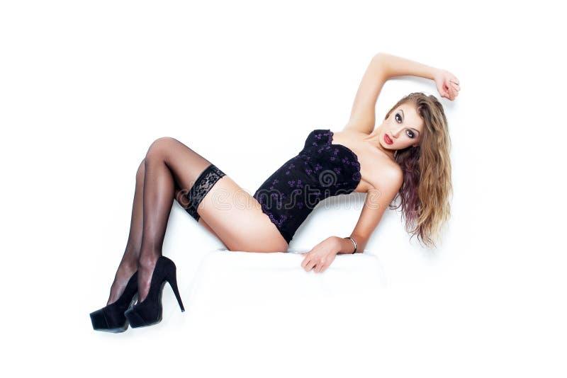 Sexy vrouw in kousen stock foto