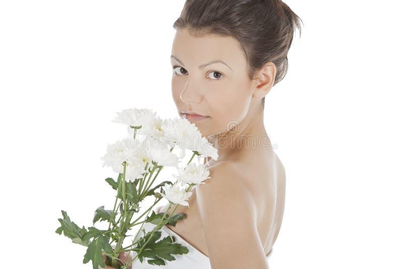Sexy vrouw met een witte bloem. stock afbeeldingen
