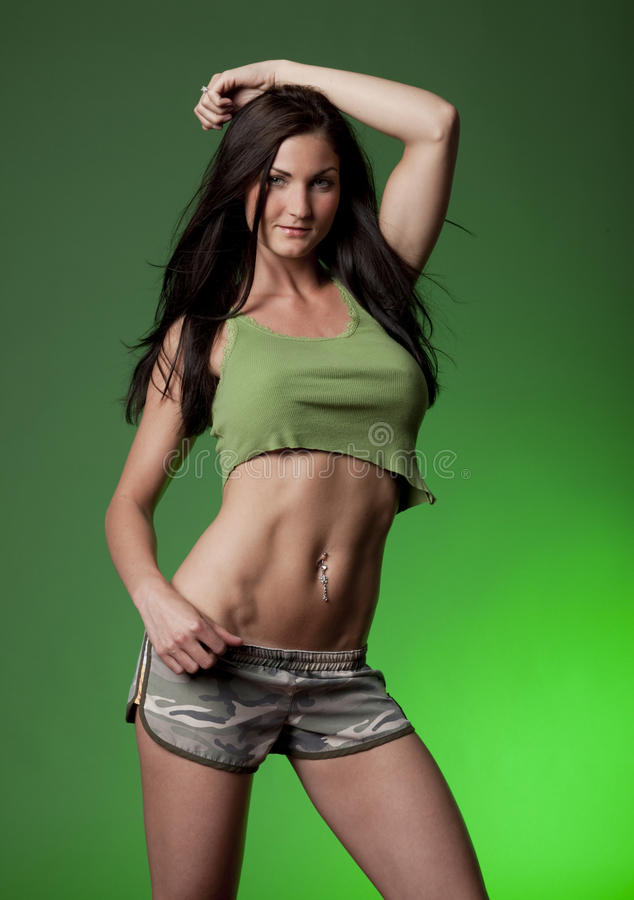 Sexy Vrouw op Groene Achtergrond stock foto's